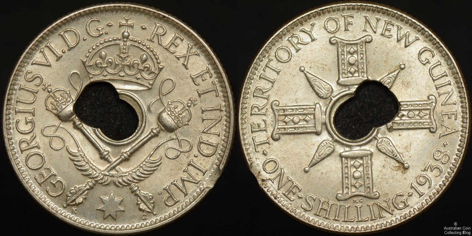 New Guinea 1938 Shilling Double Centre Hole/Off Centre Hole Error with Edge Clip